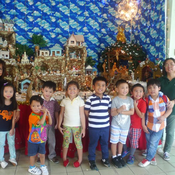 The group posed by the spectacular Nativity village at the convent.